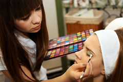 Young woman getting beautiful makeup Royalty Free Stock Photography