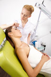 Young woman getting beauty skin mask treatment on her face with. Young women getting beauty skin mask treatment on her face with brush Stock Photography