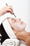 Young woman getting beauty treatment Stock Images