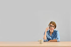 Young woman getting bored with conversation on the phone Royalty Free Stock Image
