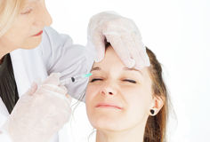 Young woman getting botox in her frown Royalty Free Stock Photography
