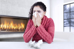 Young woman getting cold and flu at home Stock Image