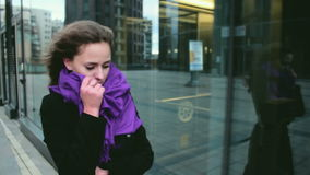 Young woman getting cold outside stock footage