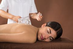 Young woman getting cupping treatment Royalty Free Stock Image