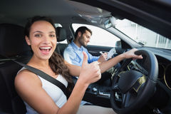 Young woman getting a driving lesson Stock Image