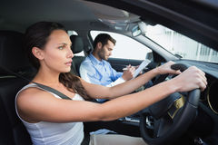 Young woman getting a driving lesson Royalty Free Stock Image