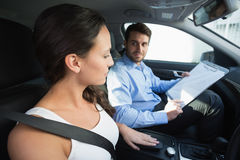 Young woman getting a driving lesson Royalty Free Stock Images