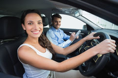 Young woman getting a driving lesson Stock Photography