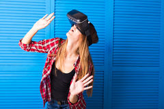 Young woman getting experience using VR-headset glasses of virtual reality much gesticulating hands Stock Photos