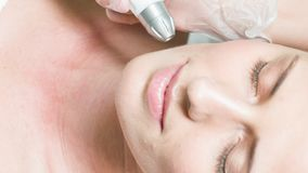 Young woman getting facial skin care treatment stock footage