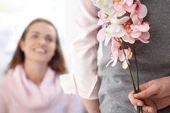 Young woman getting flowers from boyfriend Stock Images