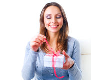 Young Woman Getting Gift Royalty Free Stock Photos