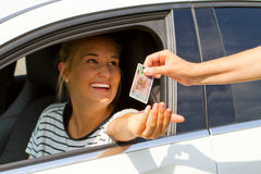 Young woman getting her driver license Royalty Free Stock Image