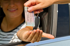 Young woman getting her driver license and car key Stock Photos
