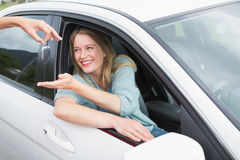 Young woman getting her new car key Royalty Free Stock Photo