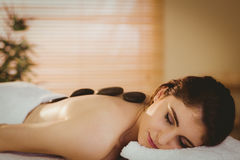 Young woman getting a hot stone massage Royalty Free Stock Image