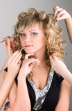 Young woman getting a make-up Stock Images