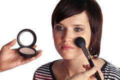 Young Woman Getting Make Up Done. Young Female Model Getting Make Up Applied By Professional Stock Photos