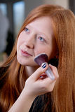 Young woman is getting makeup Royalty Free Stock Photography