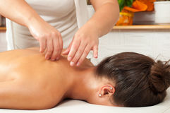 Young woman getting massage Royalty Free Stock Image