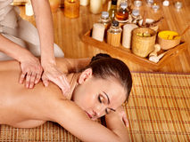 Young woman getting massage in bamboo spa Stock Image