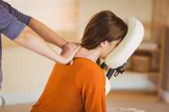 Young woman getting massage in chair Stock Image