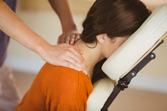 Young woman getting massage in chair Royalty Free Stock Photos