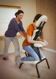 Young woman getting massage in chair Stock Photos