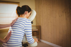 Young woman getting massage in chair Royalty Free Stock Image