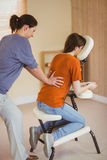 Young woman getting massage in chair Royalty Free Stock Photo
