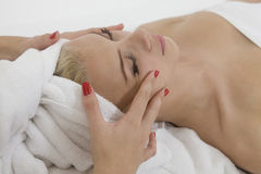 Young woman getting massage from female hands Royalty Free Stock Images