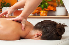 Young woman getting massage in massage salon Stock Photo
