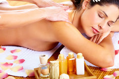 Young woman getting massage in spa salon. Young beautiful woman getting massage in spa salon Royalty Free Stock Photography