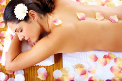 Young woman getting massage in spa salon. Stock Photo