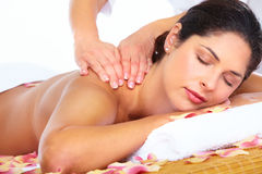 Young woman getting massage in spa salon. Royalty Free Stock Image