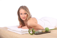 Young woman getting a massage in spa Stock Images
