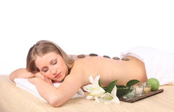 Young woman getting a massage in spa Royalty Free Stock Images