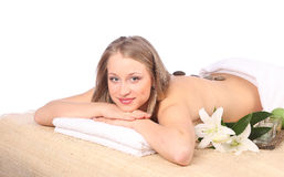 Young woman getting a massage in spa Royalty Free Stock Photography