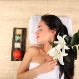 Young woman getting a massage in spa Royalty Free Stock Image