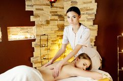 Young woman getting a massage in a spa Stock Photo