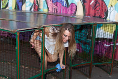 Young woman getting out of the cage Royalty Free Stock Images