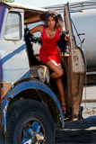 Young woman getting out of a truck Stock Image