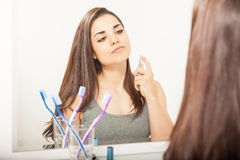 Young woman getting ready for a date Stock Photos