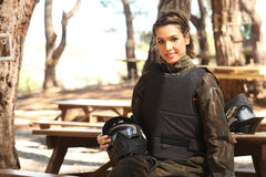 Young woman getting ready for paintball Stock Images