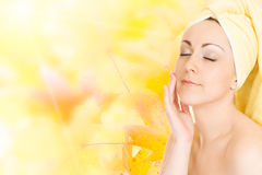 Young woman getting ready for the spa treatment on. Autumn background Royalty Free Stock Photography