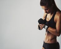 Young woman getting ready for workout Royalty Free Stock Photos