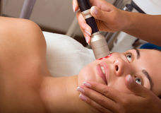 Young woman getting skin cleaning at beauty salon Royalty Free Stock Images