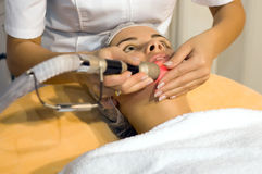 Young woman getting skin cleaning at beauty salon Stock Photo