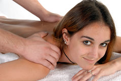 Young woman getting spa massage. Young woman getting pampered with a massage while in a spa Royalty Free Stock Images