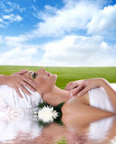 A young woman is getting spa treatment Stock Images